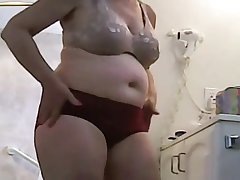 A meaty 52 years old female with big saggy tits and a round fat ass.