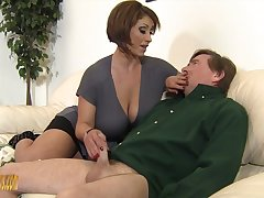 Mega take charge mistress Kyle Stone gives boots job and boobs job to her submissive