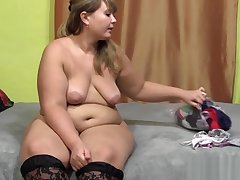 Cute young buxom woman with hairy by a pussy, trying on her panties and