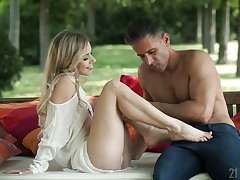 Lovely blond pet Nesty gives a beautiful blowjob in the garden
